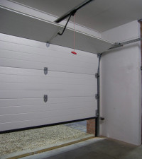 how to manually open garage door from inside