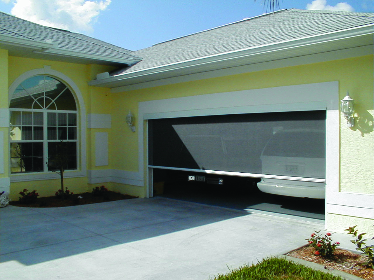Garage door screen worcester door company for Roll down garage door screen